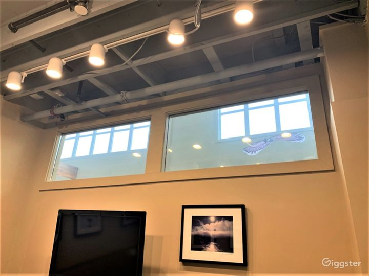 Natural light gets into even this internal meeting room, via transom windows.
