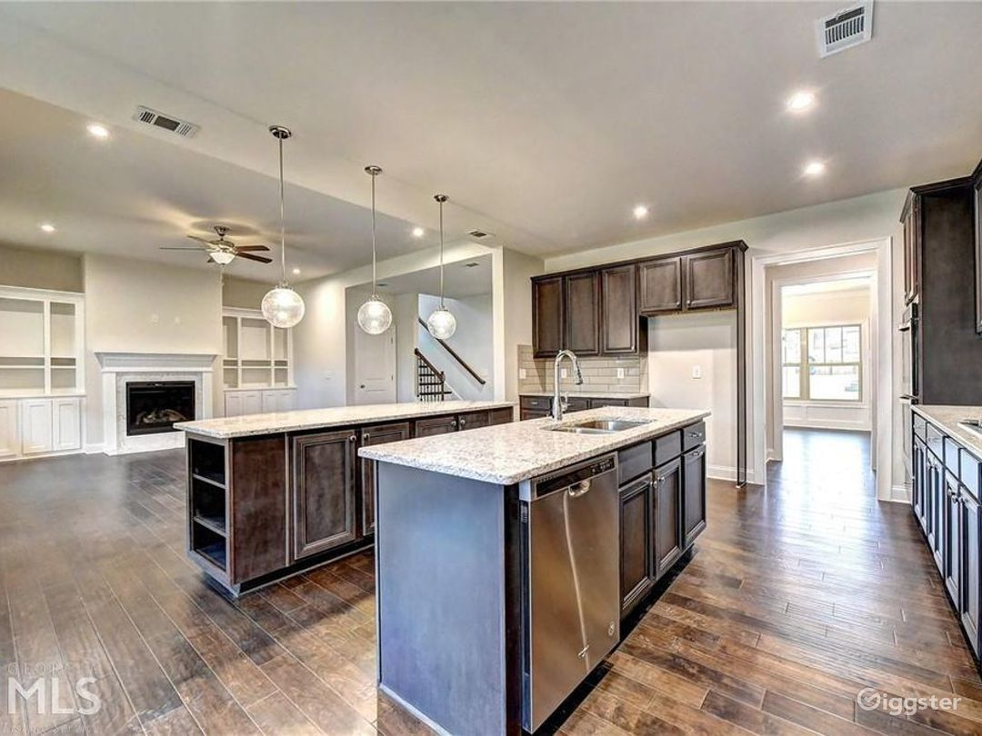 Double Island Kitchen into Family Room From Breakfast Nook Area