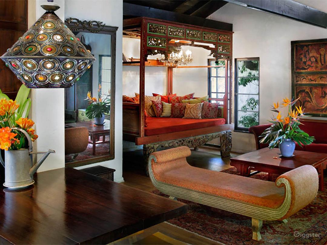 Living room has high ceilings. Could hang lighting off of beams.