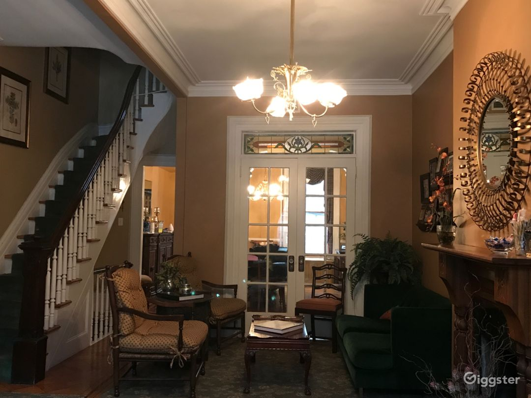 original detail including ceiling medallion, moulding, stained glass transom, ornate fireplace mantel, dramatic staircase, working gas fireplace