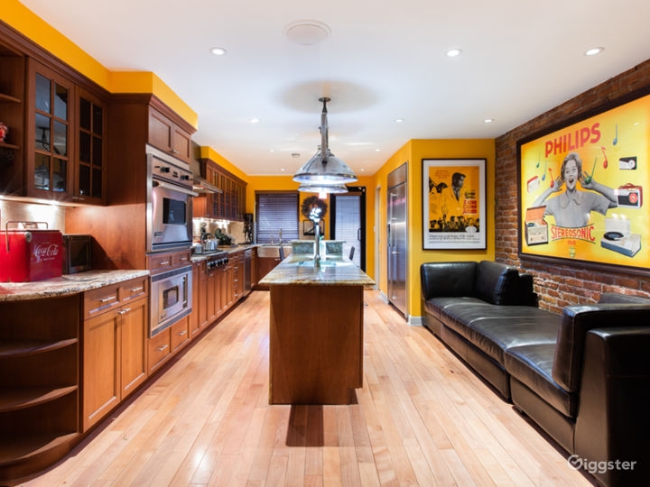 Open Kitchen: Marble countertops and island, Viking stove, oven and microwave, suspended 1940s hospital operating light fixtures, original 1950's movie and French music poster art, custom leather banquet seating, wine cooler