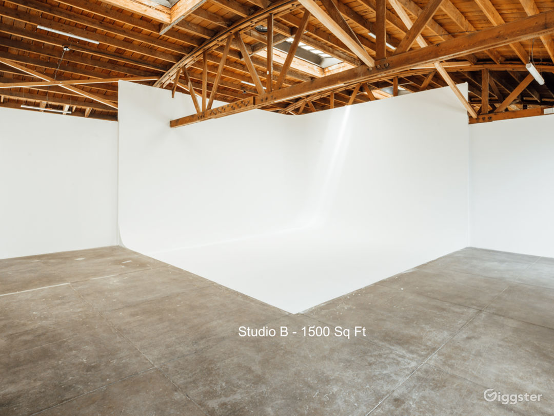 Studio B - 1500 Sq Ft  Featuring a large L-shaped cyclorama, attached glam room, exposed brick, and midday light beaming through the skylights, Studio B is perfect for shoots requiring more control over external lighting.