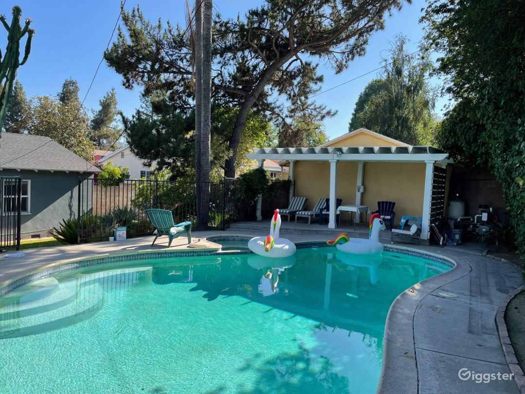 Amazing gigantic pool with a newly built Pergola and two unicorn floaties:)