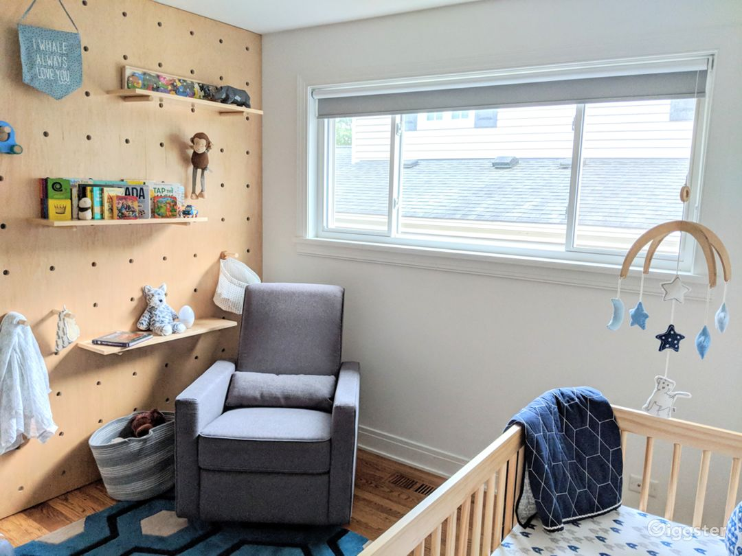 Mid-century modern, minimalist, white nursery with a feature DIY pegboard wall.