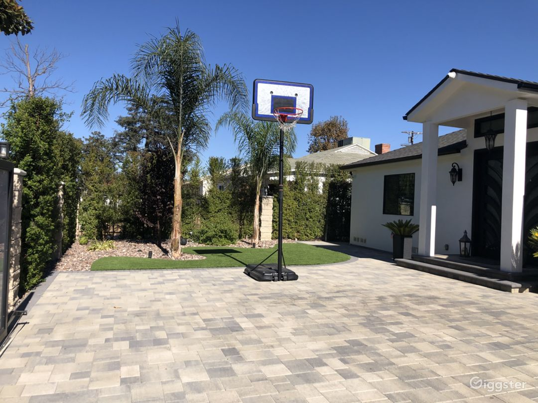 Front yard with half court and plenty of parking