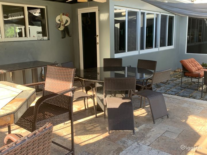marble table with seating for 6 in the outdoor kitchen.  Overlooks the pool deck