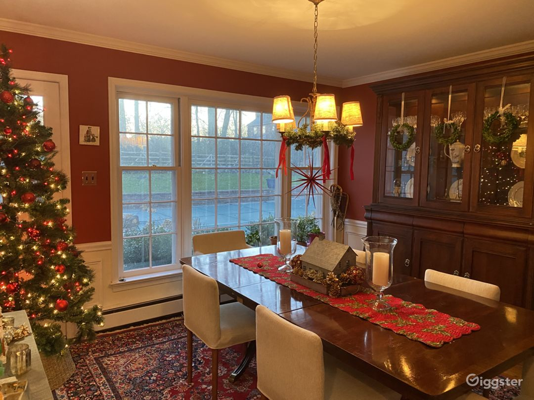 Dining room, seats ten comfortably, large picture window overlooking landscaping and saltwater pool/outdoor fireplace