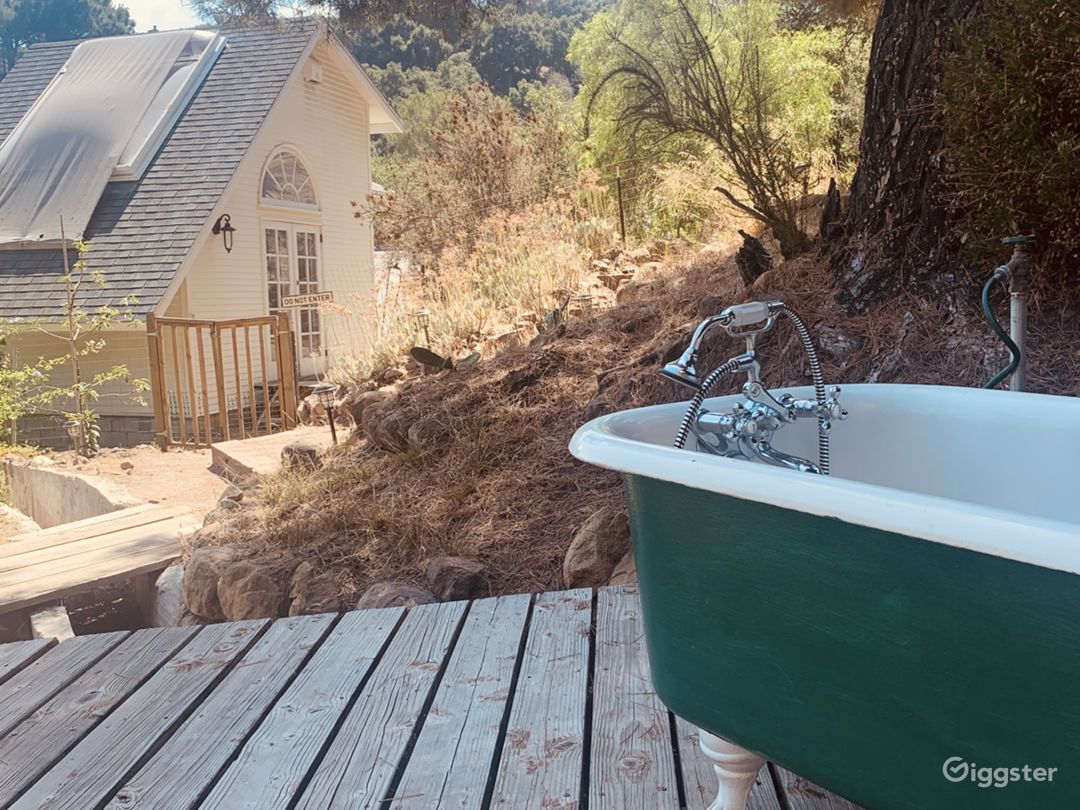 Outdoor bathtub overlooking guest house and Mountain View's.