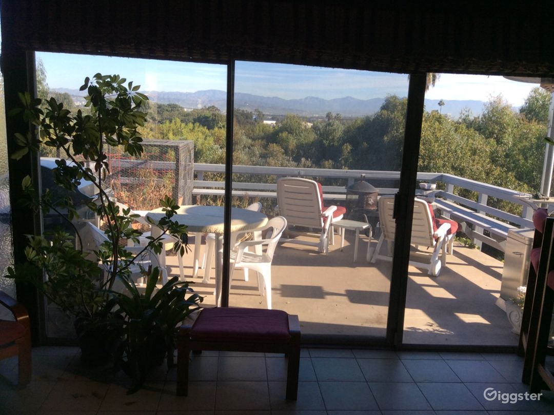 View of Hollywood hills and sundeck from family room