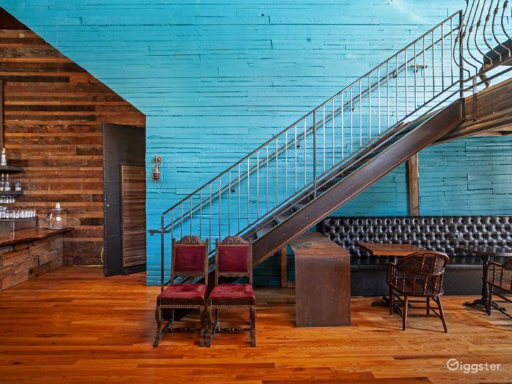 Main Floor stairs to balcony with basement Venue door seen open