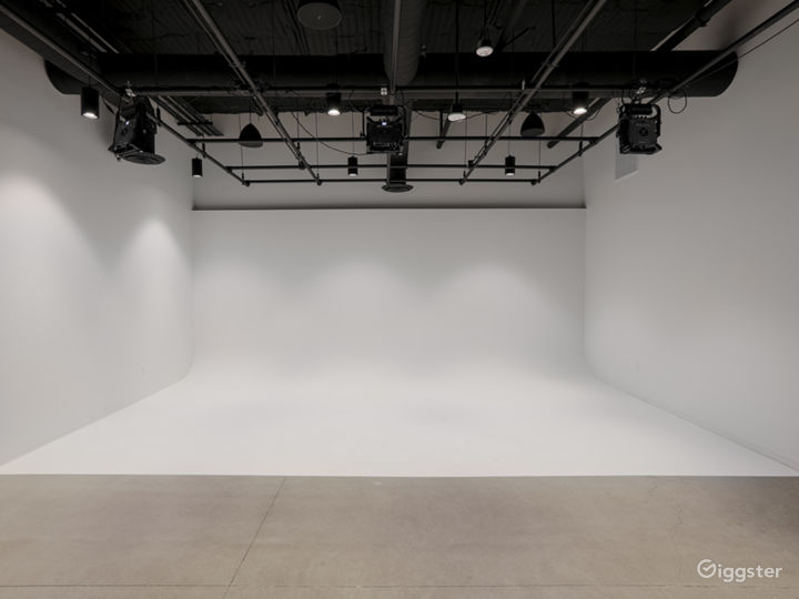 White cyclorama with full lighting grid