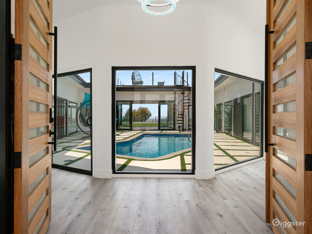 Welcoming modern courtyard Pool View as you open the modern double entrance door