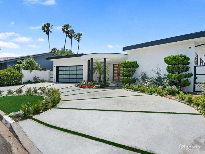 Modern setting with luxurious circular driveway