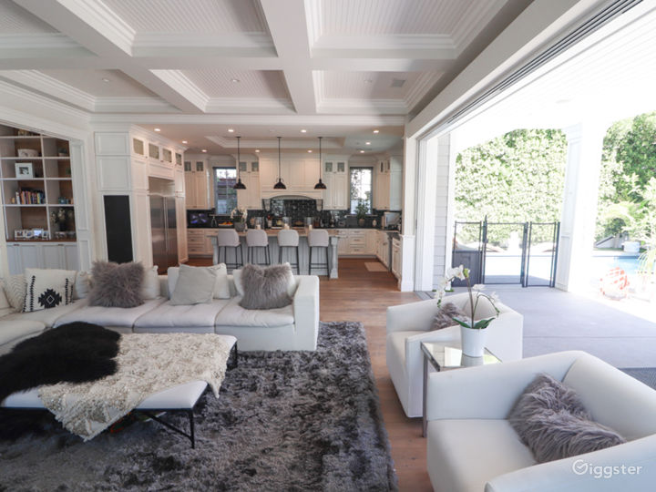 The Family Living Room has an open floor plan that extends to the beautifully-designed kitchen and expansive backyard.