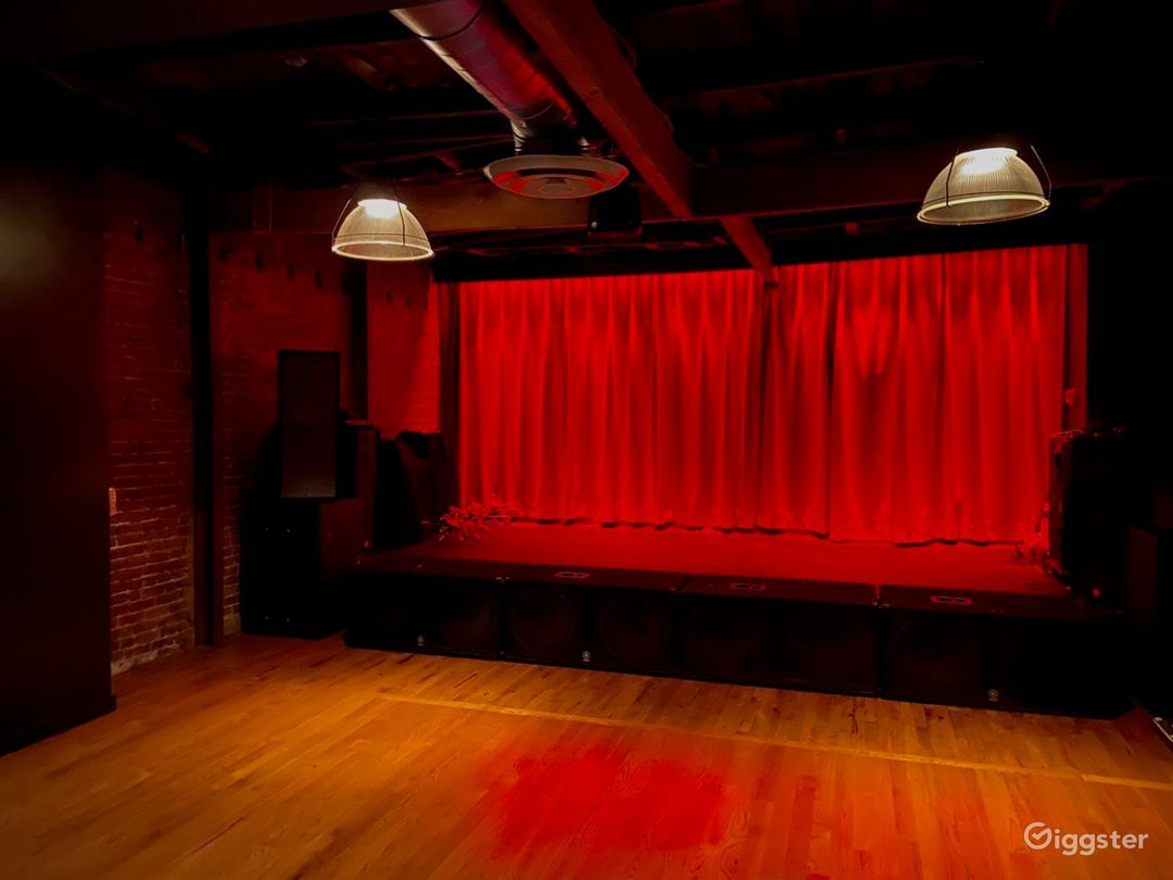 Upstairs showroom stage, 1500 sq-ft space, wood floors w/ private bar in space