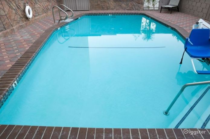 Atmospheric Patio with a Pool Photo 1