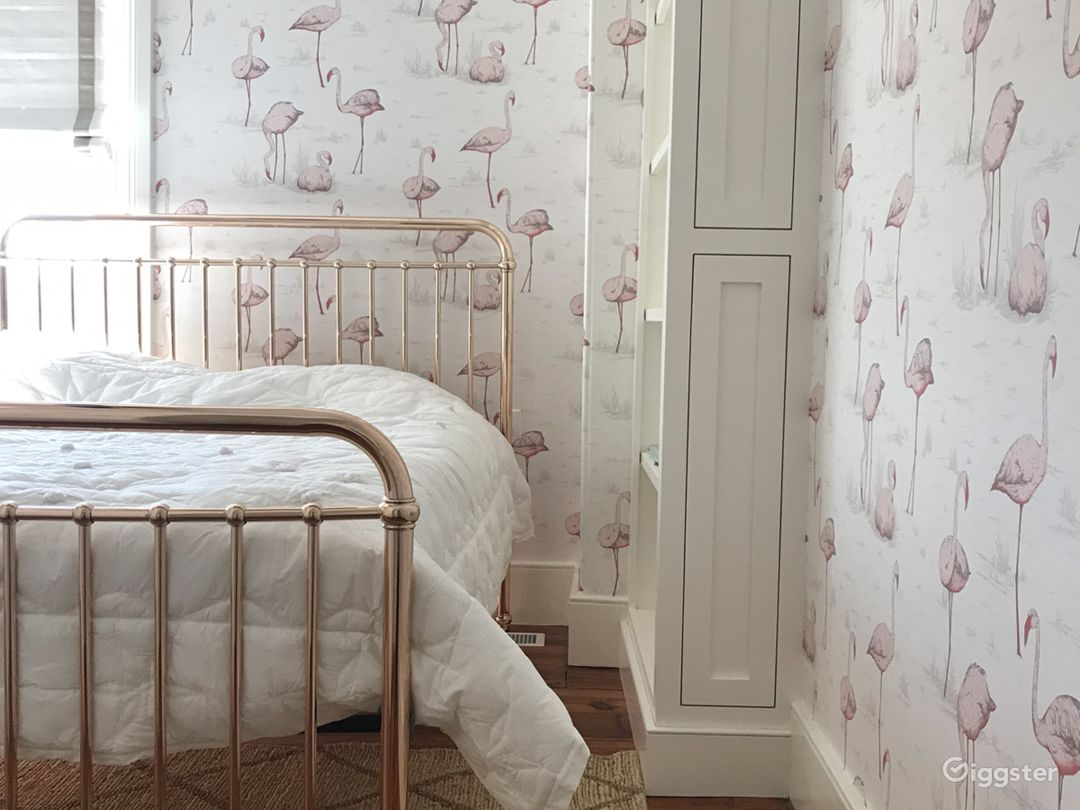 bedroom with walls in wading flamingoes wallpaper in white from cole & son