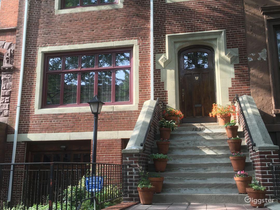 Extra-wide, 25-foot brick townhouse on landmarked Brooklyn street.