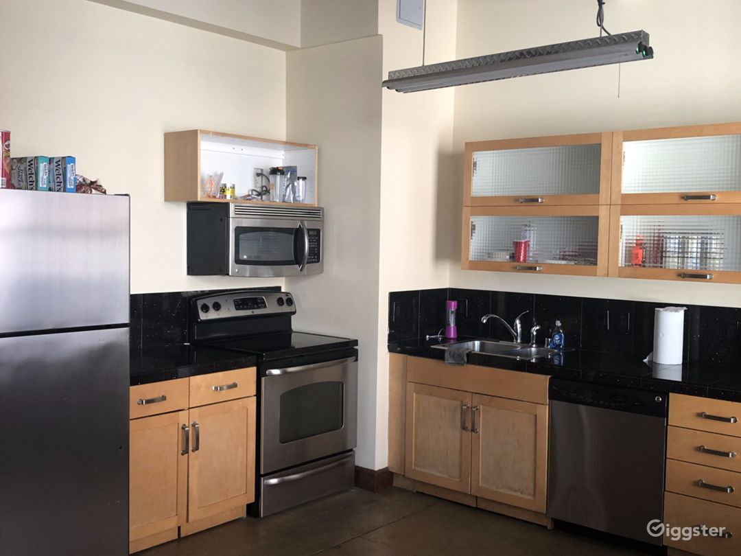 Kitchen. Granite counter tops, glass top stove, microwave, dishwasher,  and a GE fridge that includes an icemaker. Plenty of counter top space and cabinets for storage.