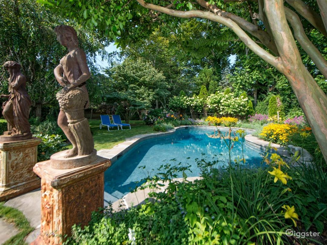 Free-form heated pool with surrounding English gardens