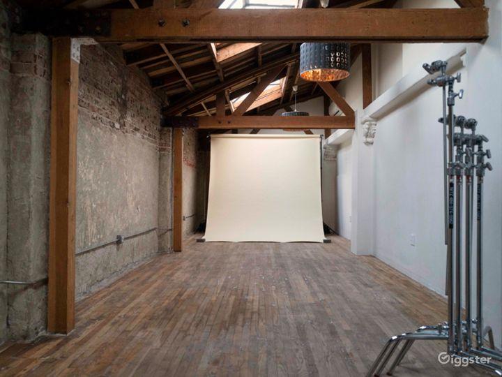 Exposed wood beams, brick walls, and skylit studio Photo 2