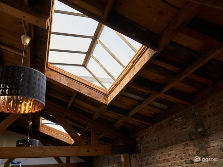 Exposed wood beams, brick walls, and skylit studio Photo 4