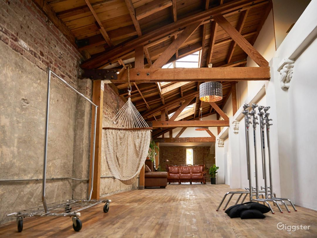 Exposed wood beams, brick walls, and skylit studio Photo 1