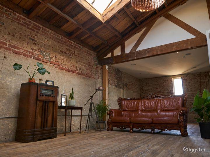 Exposed wood beams, brick walls, and skylit studio Photo 3