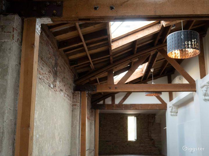 Exposed wood beams, brick walls, and skylit studio Photo 5
