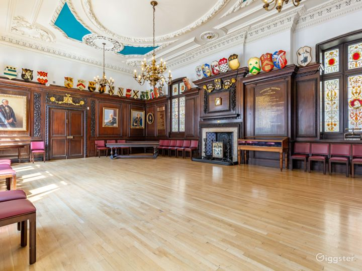 Warm character room with wood panelled walls and stain-glass windows