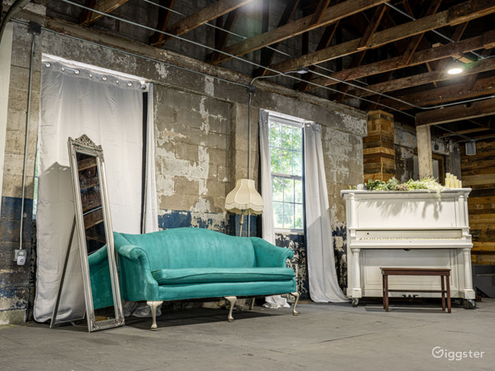 Props include an antique piano, floor length mirror and 4 couches, an egg chair and a mobile claw foot tub.