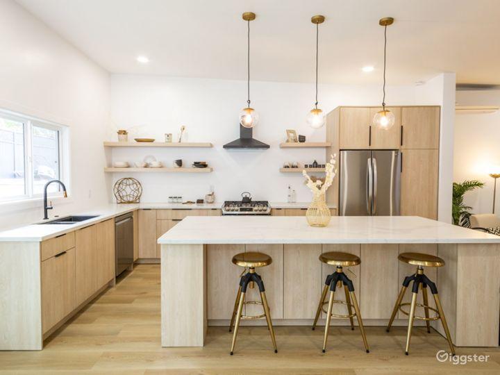 Large mid century kitchen with large Calacatta island