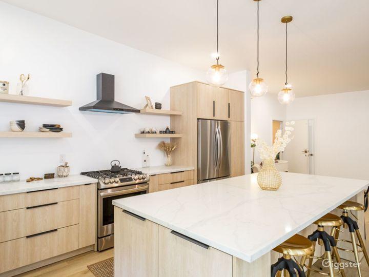 Kitchen with large Calacatta island