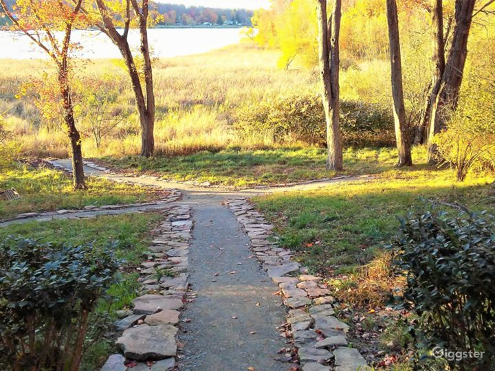 Pathway to the backyard and edge of the property fronting the lake