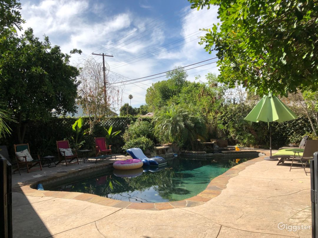 Backyard saltwater pool with 2 working water falls. Large areas along both sides of pool to support large amount of seating or crowds. Open floor plan flow into the patio seating/fireplace/wet bar