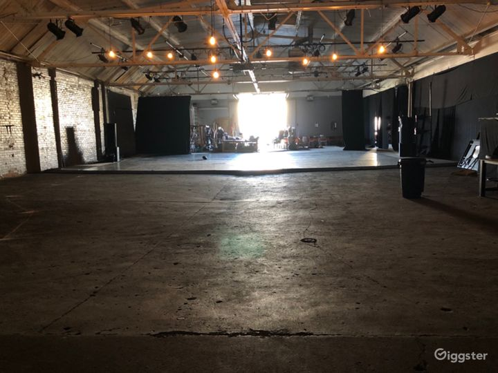 Open warehouse with theatre lighting grid and dance floor