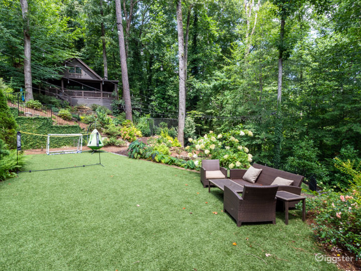 View of cabin including turf and putting green areas