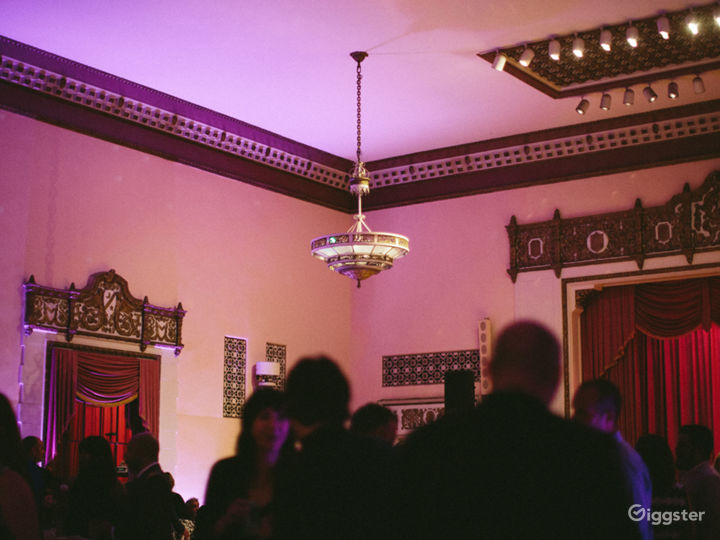 Antique chandeliers hang from a high ceiling.