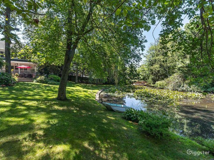 Beautiful Backyard with Breathtaking Lake Photo 3