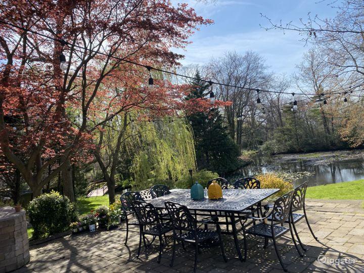 Beautiful Backyard with Breathtaking Lake Photo 5