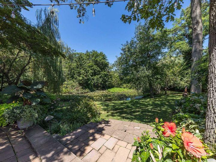Beautiful Backyard with Breathtaking Lake Photo 2