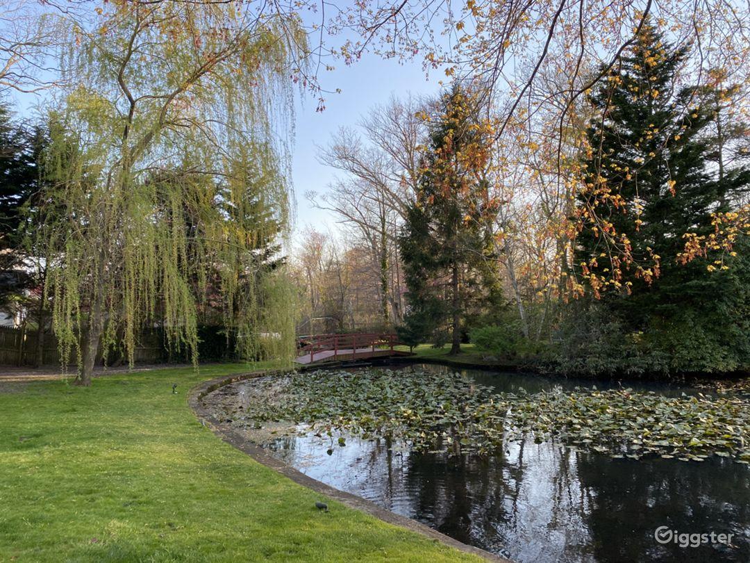 Beautiful Backyard with Breathtaking Lake Photo 1