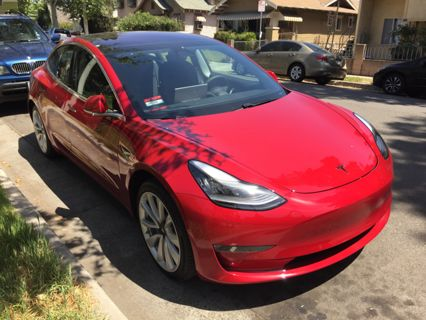 Tesla Model 3 in red   Rent this location on Giggster