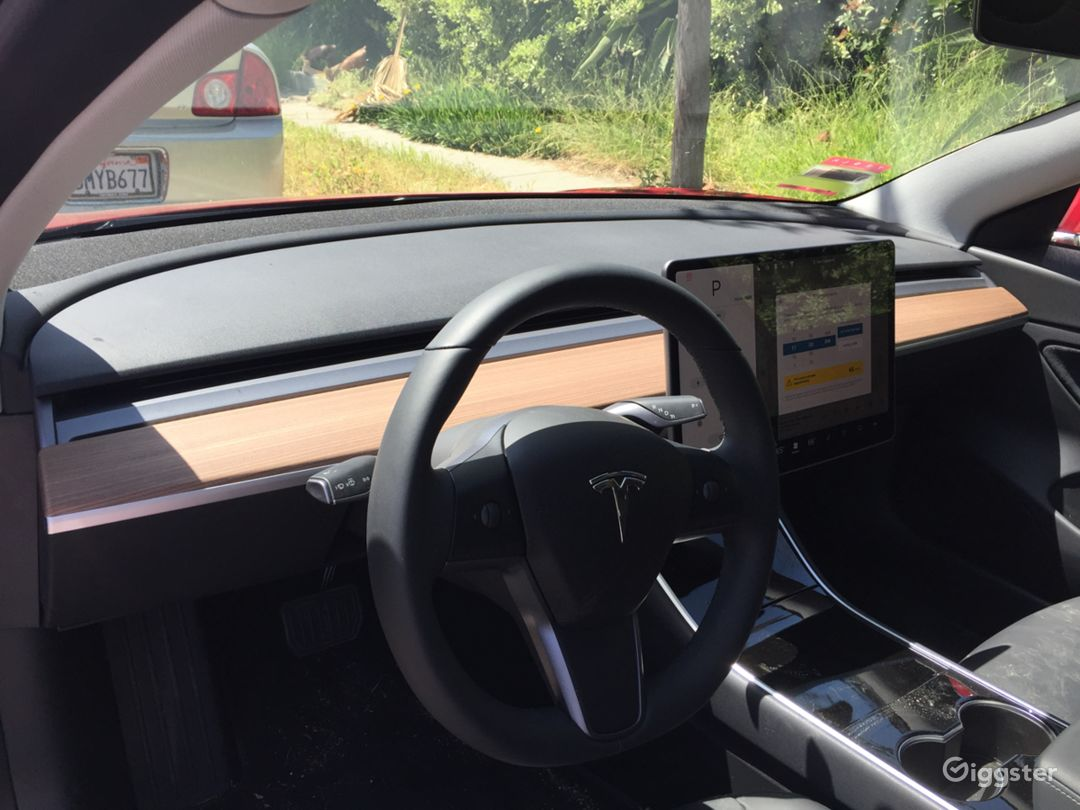 Tesla Model 3 dashboard. There aren't any buttons. Just a centered, tablet-like screen.