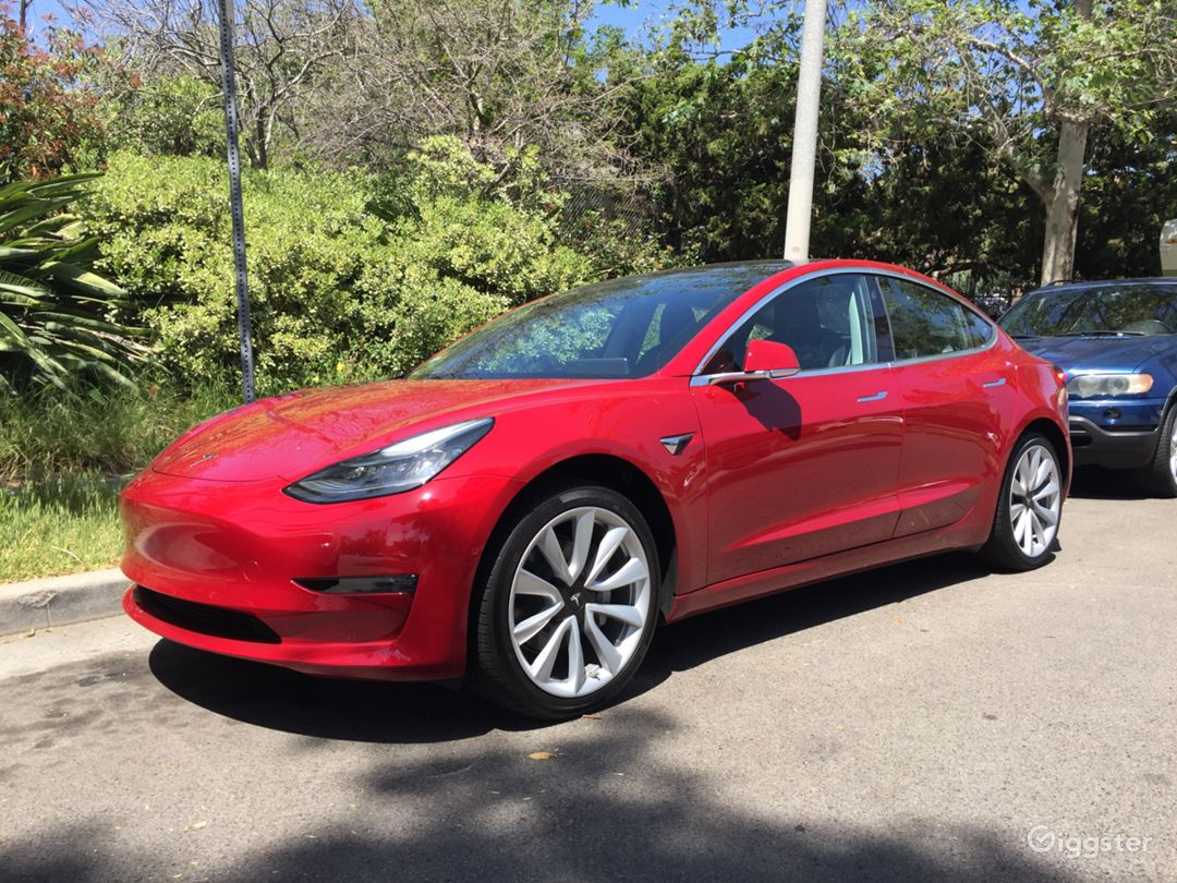 Tesla Model 3 with panoramic roof, 19-inch wheels and 310 miles of range.