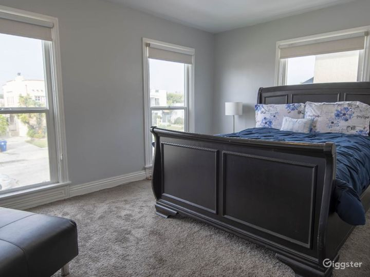 Master bedroom with floor-to-ceiling windows and an adorable chase lounge!!!