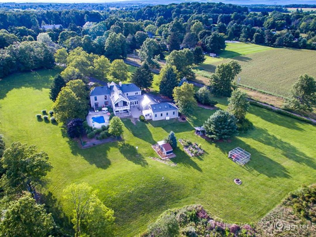 Drone shot of the property. A total of over 3.5 lush acres with wide open fields and beautiful landscaping.