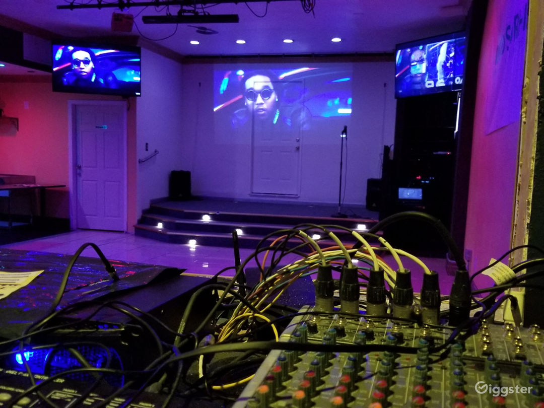 Sound booth View to stage. Full HDMI, Mixing Board, Light controls, remote control television for all channels, Radio Receiver, full control of house and stage microphones, capability to record live sound professionally throughout venue.