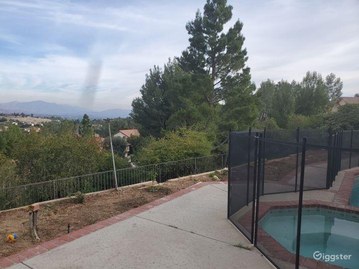 Film location: Backyard-Walkway encompassed by Pool (gate is removable), Hillside