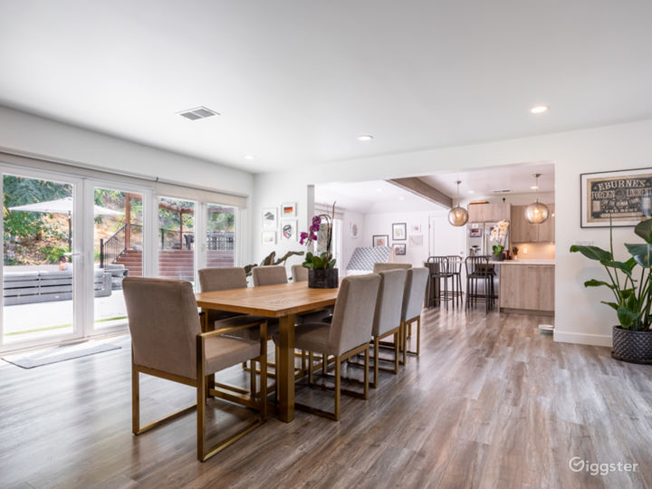 Dining area with large natural wood table that seats up to 10